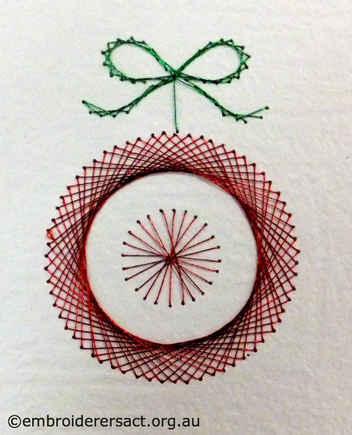 Xmas decoration stitched on paper