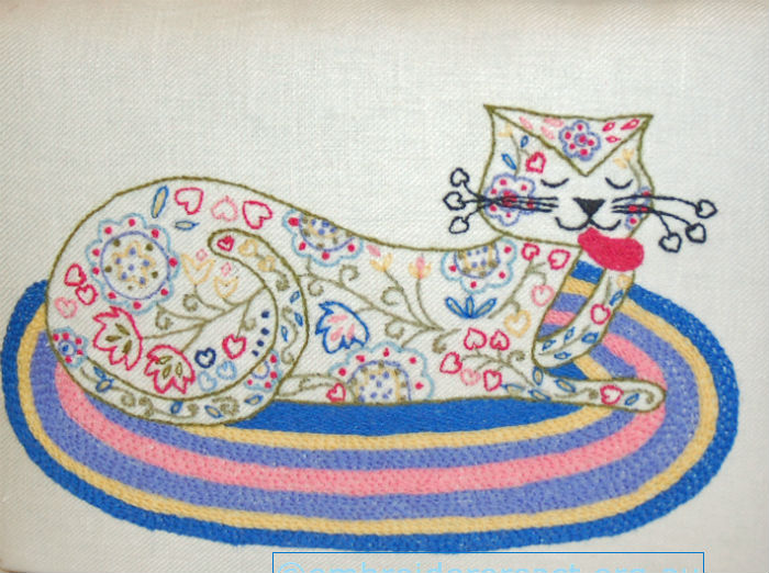 Crewel Cat Footstool stitched by Marjorie Gilby