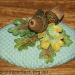 Detail of stumpwork acorns stitched by Yvonne Kingsley
