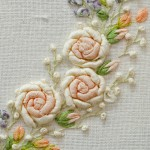 Detail Silk ribbon roses on embroidered heart in Collection