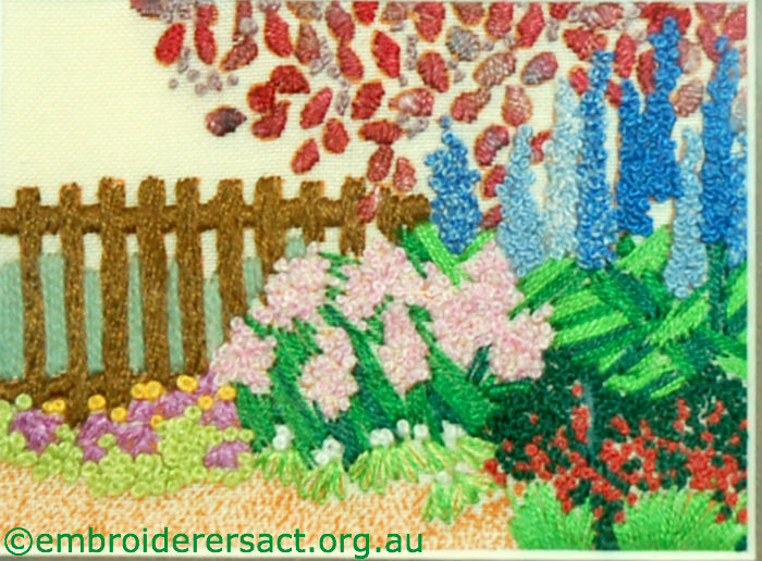 Garden fence embroidery stitched by Kathy Pascoe