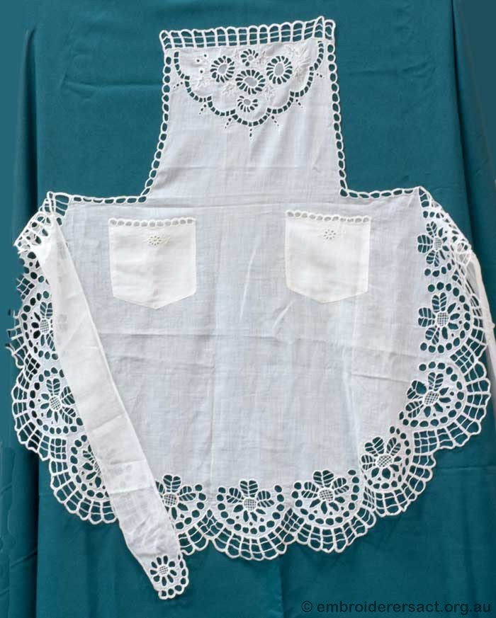 A white on white cotton Apron