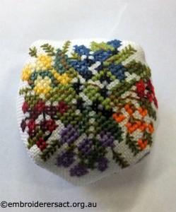 Flower biscornu stitched by Helen Nastopoulis