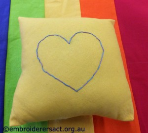 Kimberley yellow pillow and rainbow bag