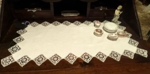 Table runner with reticello squares edging