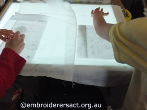 Young stitchers using lightbox