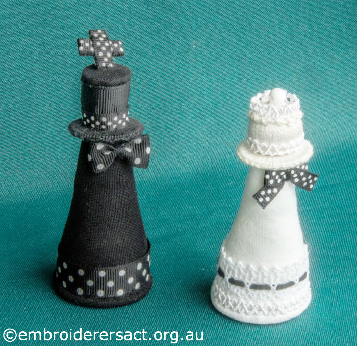 Detail of 2 stitched Chess Pieces