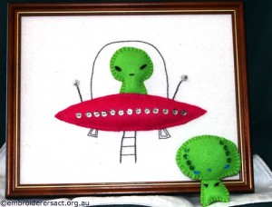 Alien in space ship and alien feltie stitched by Jillian Bath