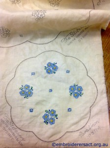 Vintage Embroidery with Blue Flowers stitched by Jillian Farrer