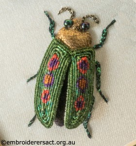 Green Stumpwork Beetle with Red and Purple Patches stitched by Lorna Loveland