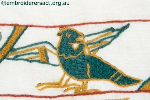Green bird on Bayeux panel stitched by Gail Haidon
