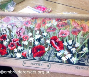 Red Poppy in Progress x-stitched by Margaret Kilby