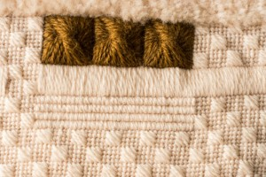 Brown and Cream Aran Cushion stitched by Audrey Schultz