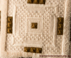 Centre Square of Brown and Cream Aran Cushion stitched by Audrey Schultz