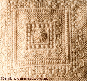 Centre Square of Cream Aran Cushion stitched by Audrey Schultz