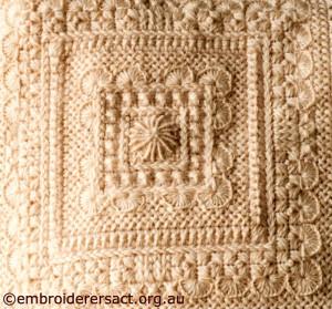 Centre Square of Cream Aran Cushion stitched by Audrey Schultz