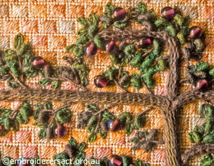 Stitchery of espaliered plum tree