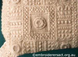 Corner Detail of Cream Aran Cushion stitched by Audrey Schultz