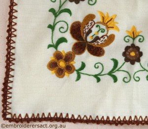 Corner of Tablerunner with Brown and Gold Hungarian Embroidery belonging to Elizabeth Hooper