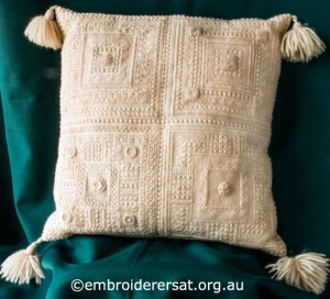 Cream Aran Cushion stitched by Audrey Schultz