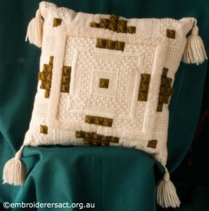 Cream and Brown Aran Cushion stitched by Audrey Schultz