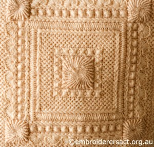 Detail 2 of Cream Aran Cushion stitched by Audrey Schultz