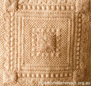 Detail 2 of Cream Aran Cushion stitched by Audrey Schultz