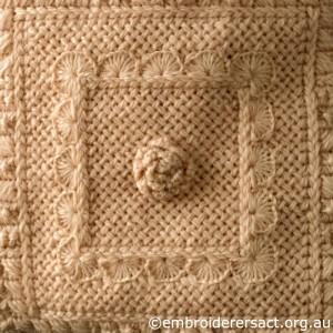 Detail 3 of Cream Aran Cushion stitched by Audrey Schultz
