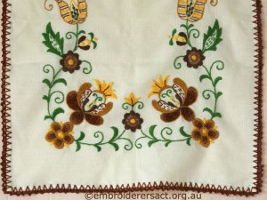 Detail of Tablerunner with Brown and Gold Hingarian Embroidery belonging to Elizabeth Hooper