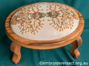 Crewel work stool with Autumn Leaves stitched by Marjorie Gilby