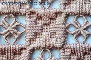Close up 2 from Pink Hardanger Mat stitched by Marjorie Gilby