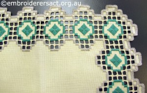 Corner of Hardanger Square with Green Diamonds stitched by Levona Lea