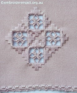 Hardanger Motif on Pink Mat stitched by Marjorie Gilby