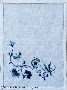 Deerfield Embroidery Napkin stitched by Marjorie Gilby