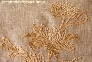 Detail 1 of Waratah Tray Cloth stitched by Marjorie Gilby