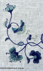 Detail 2 of Deerfield Embroidery stitched by Marjorie Gilby