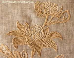 Detail 2 of Waratah Tray Cloth stitched by Marjorie Gilby