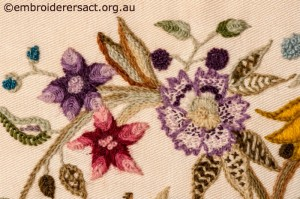Detail 3 of Crewel Cushion 1 stitched by Audrey Schultz