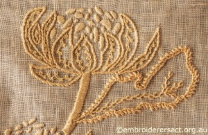 Detail 3 of Waratah Tray Cloth stitched by Marjorie Gilby