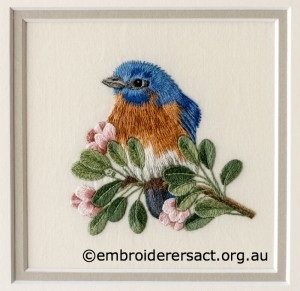 Detail 1 of Eastern Bluebird stitched by Sharon Burrell
