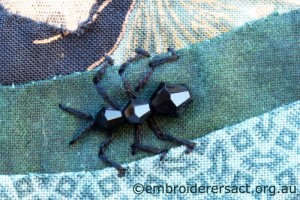 Detail 2 of Reverse Applique with Ants by Pat Bootland