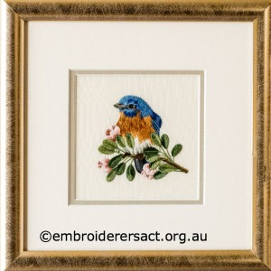 Eastern Bluebird stitched by Sharon Burrell
