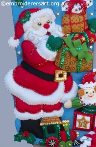 Detail 1 of Santa Stocking stitched by Jillian Bath