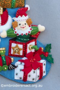 Detail 2 of Santa Stocking stitched by Jillian Bath