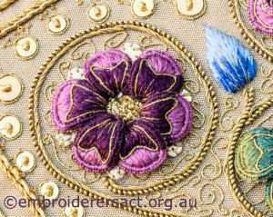 Detail 2 of Siennese Illuminated Treasure stitched by Fran Novitski
