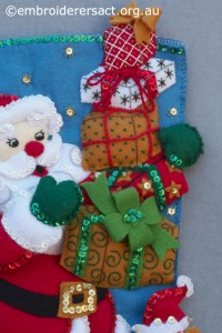 Detail 3 of Santa Stocking stitched by Jillian Bath