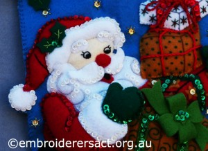 Detail 4 of Santa Stocking stitched by Jillian Bath