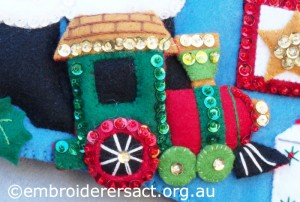 Detail 5 of Santa Stocking stitched by Jillian Bath