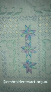 Detail 1 of Hardanger Acqua and Mauve Piece in Progress stitched by Avis Gesling