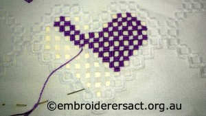 Detail 1 of Hardnager Purple Heart Piece in Progress stitched by Elizabeth Hooper